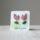 Coppia di orecchini Tulipano in ceramica. Orecchini artigianali in ceramica con base in acciaio anallergico su supporto in carta e acquerello.